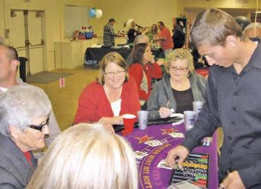 El Tejon Unified School District Superintendent Katie Kleier (red coat in middle) enjoyed the fun. Gaming tables were a success as about 90 players enjoyed the Frazier Mountain High School Booster Club's Casino night. The event is the largest fundraiser for the year to assist FMHS sports teams.
