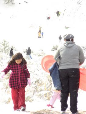 Families play at Snowbunny Hill on the eastern end of Cuddy Valley. [photo by The Mountain Enterprise]