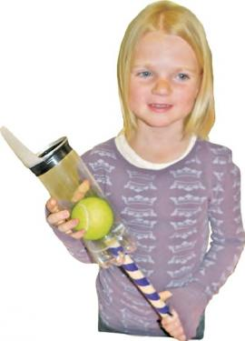 Madalin Bierer created the Ball Launcher to scoop to play ball with her dog without getting dog slobber on her hands.