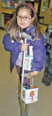 Daniela Garrido made Helpful Crutches with pockets to help carry things such as water, snacks and toys while using crutches.