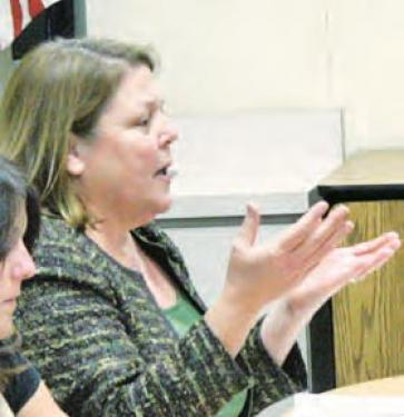 Supt. Katie Kleier makes a point, Paula Regan gets sick and Anita Anderson listens intently as (prior photos) Steve Kiouses, John Fleming and Ken Hurst debate major changes to Frazier Mountain High School.