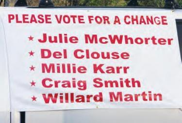 This November 2011 banner shows the slate of &quotreform&quot candidates proposed at a rally by those who wanted to see the water rate increase nullified. Prominent among them were employees of the owner of a mobile home park who felt it was being overcharged under the new guidelines. The top three candidates on this list won election, along with incumbent Julie McWhorter who supported the rate increase and then told voters she changed her mind. The fifth director elected was William Hopper. [Campaigners misspelled the name of Delbert Clowes on the banner above.]