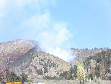 A fire burns in the shooting range area of Frazier Park, above Fire Station 57. [photo by The Mountain Enterprise]