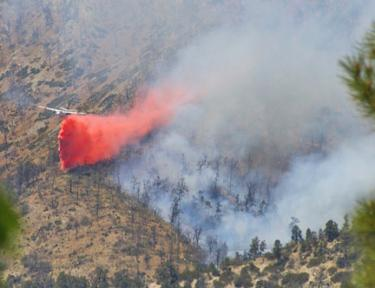 Another photo of the tanker dropping retardant on the Range fire. [Lance Borgstrom photo]