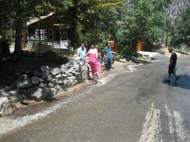Gushing water from a broken main near Pine Canyon in Frazier Park (a block above the library) provided kids a nice place to wade on Saturday afternoon. FPPUD water operator, Jonnie Allison, got the leak fixed by 1 a.m. that morning.[Sturdevant photo]