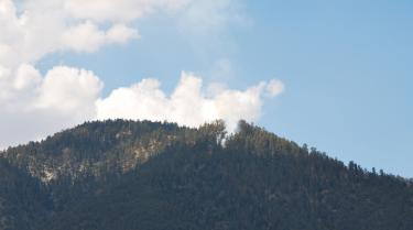 Smoke from the Point Fire on Mt. Abel, shown in a photo sent by Scott Watters of Pine Mountain.