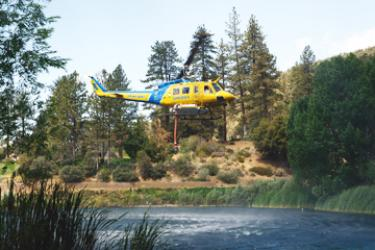 Barry Ailetcher snapped this shot of Ventura County helicopter 6 snorkeling water from Fern's Lake in Pine Mountain to fight the Point fire near the top of Mt. Abel.