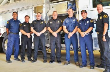 The crew from Kern County Fire Department Station 55,with Olympic cyclist Jimmy Watkins (third from right). His co-workers helped make it possible for Watkins to compete in the London 2012 event. At far right, beaming proudly, is Kern County's Fire Chief Brian Marshall [Gunnar Kuepper photos]