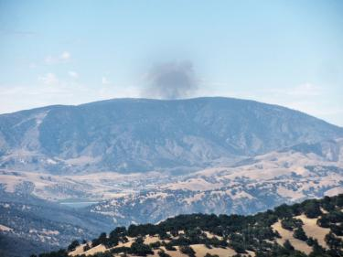 Viewed from high atop Tejon Ranch at Jim and Fay Lumsden's Eagle's Perch, the smoke plume rises about 15 miles beyond Frazier Mountain. [photo by Jim and Fay Lumsden]