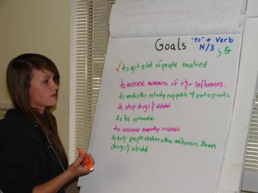 Allie Barry of MyC3 (Mountain Youth Can Change Communities) leads a work session for McCASA.