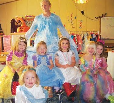"""A daycare provider'swork is never done,""writes Robin Barrington atRobin's Nest Preschool inLebec. ""What a day! I hadto dress as a princess,drink tea (apple juice)from small tea cups, eatheart shaped sandwichesfrom fine china, dance(which included lots oftwirling), paint six littleprincesses' fingernails'pink...and I had a blast!""She sent a photo of theglass shoes (and sorebaby toes) to prove it.Wendy Watson and 3-yearoldChloe took photos."