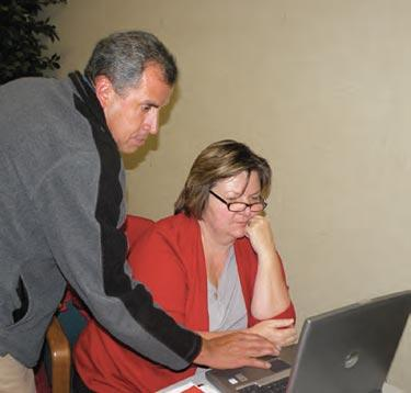Fernando Nieto, newly named as ETUSD chief business officer (CBO), goes over data with Audrey Weingarten, administrative assistant for district.