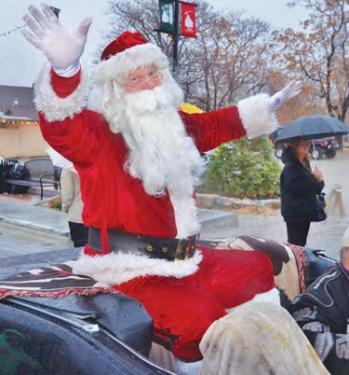 Santa was in spirited form throughout the parade. Merry Christmas! [Gunnar Kuepper photo]