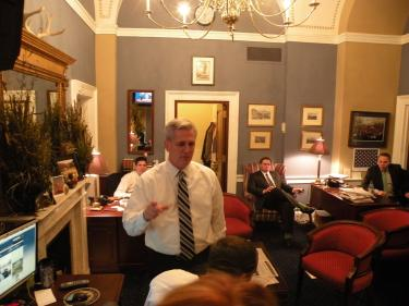 House Majority Whip Kevin McCarthy, from Bakersfield, talking with staff in the Whip Room where lists of representatives and their votes on critical issues are kept in a database. The whip's office is down the hall and around a corner from the U.S. House of Representatives chambers. On December 31, 2012 as U.S. Congress teetered on the brink of the fiscal cliff, Congressman McCarthy graciously provided a tour before dashing up to a meeting in Speaker of the House John Boehner's office to learn more about the senate negotiations. [Gary Meyer for The Mountain Enterprise]