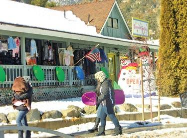 Some businesses were ready with merchandise for snow play visitors. Muffins and cookies were for sale at the Frazier Mountain Park entrance. Families had a great time playing in the snow, but drivers were challenged.