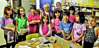 Children from Pine Mountain Learning Center on Career Day, learning about making newspapers.[HEDUND PHOTO]