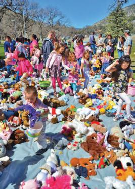 Children exchanged their plastic eggs for selections from an endless garden of bright toys donated from the community.
