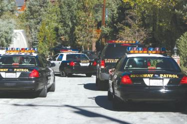 California Highway Patrol and Los Angeles County Sheriff?s Department provide backup for Kern County Sheriff?s Department (not shown) at Rhine Court in Pine Mountain, near a location where gunshots were heard.
