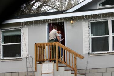 Kern County Sheriff's Deputy David Benson goes door to door Thursday, Dec. 6 in neighborhoods below the Scott Fire burn area, to alert residents to the danger of potential flooding and debris if rains become heavy. Sheriff's volunteers helped alert residents in the Cuddy Creek area on the same day.