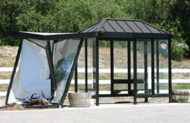 The damaged information kiosk and bus shelter on Monterey Trail, across from the Frazier Park Post Office.
