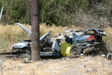 The sedan which struck a pole on Interstate 5 next to Tejon Fields, causing one fatality on Monday, Sept. 1.