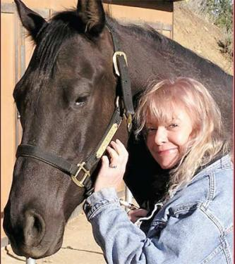 Lori Smith with her beloved thoroughbred stallion, Zydeco.