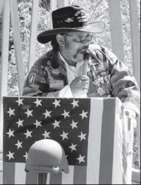 Left, Simba Roberts speaks at the Memorial Day Ceremony 2007.
