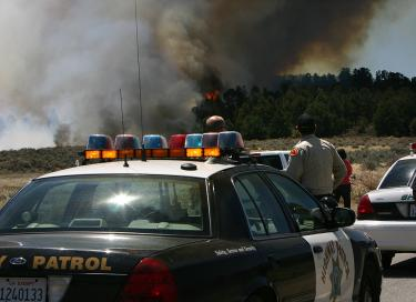 CHP officers stopped traffic on Lockwood Valley Road as a wildfire moved northwest into a stand of pine trees. Numerous community reporters called to report the fire. [Above, Gary Meyer photo; below, Linda Curtis photo] See more photos in The Mountain Enterprise April 24 issue.