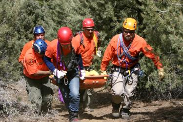 Kern County Sheriff's Search and Rescue team members bring the young man's body up from approximately 700 feet below the cliff where he fell the night before. [Photo by Gary Meyer]