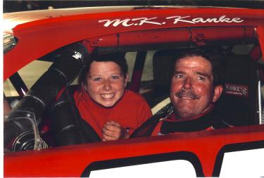 Daughter Monica and Mike ?M.K.? Kanke at a race in 2006 where he set a series all-time win lead. [Kanke photo]
