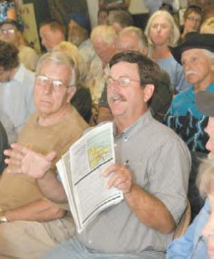 Doug Peters, above, called for a regional groundwater study before either Tejon Mountain Village or Frazier Park Estates is considered by Kern County. In June, mountain residents turned out in force to learn about the environmental impacts of Tejon Mountain Village.