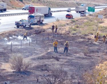 Kern and Los Angeles County engines mopping up a half-acre brush fire on northbound Interstate 5. The fire was contained within 20 minutes and threatened no homes on nearby Hayride Road.