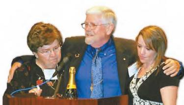 Prior editor of The Mountain Enterprise, Fred Kiesner, with wife Elaine and daughter Andrea at tearful announcement.