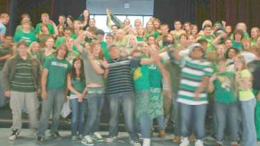 This somewhat blurry cell phone photo by Jacob Mowry shows about 70 students among many more wearing green to school on November 30, 2007 to protest perceived cover-up by administration about improper use of high school ASB funds—way back then.