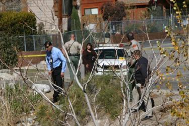 Kern County homicide investigators begin their search for evidence surrounding the body of a man found in Cuddy Creek Tuesday morning. [Mountain Enterprise photo]