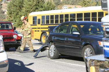 A minor traffic accident in Lake of the Woods causes an ETUSD school bus to be blocked in by emergency crews. The bus was not involved in the accident and departed for school as crews cleared the scene. [Mountain Enterprise photo]