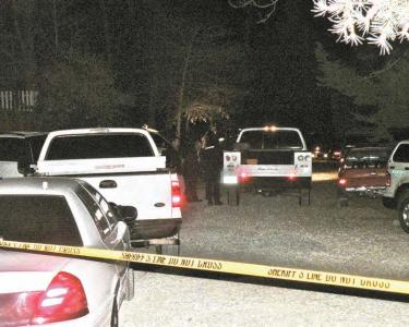 The scene on Laurel Avenue in front of the Shropshire family home near North End Drive on the evening of Sunday, Nov. 22 as a suspicious death investigation begins. The identity of the deceased man was confirmed the following day. [Mountain Enterprise photo]