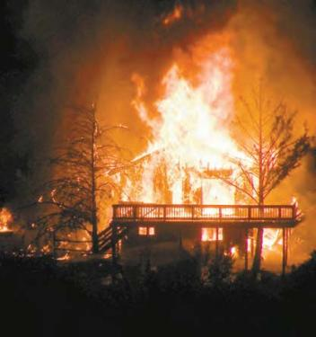 This 2,000 square foot house at St. Anton and Target in Pine Mountain was destroyed in a two-alarm fire that was fully involved by 2:50 a.m. on Saturday, Nov. 21. Firefighters from Pine Mountain, Frazier Park, Lebec, Mettler, Gorman and Lockwood Valley responded to the blaze, and the cascade of embers flowing down the hill behind it (toward St. Anton). Fire departments from Los Angeles County, KernCounty and the U.S. Forest Service sent 23 firefighters to help.[Hedlund Photos above and in slide show]