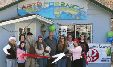 The Arts For Earth Foundation held a grand opening for its Nature Center and Gift Gallery. The Chamber of Commerce was there with a ribbon-cutting ceremony. (l-r) Stacey Havener, Courtney Peterson, Abbe Gore, Ron Edsall, Barbara Edsall, Angus, Roy Wells, Cassandra Peterson, Mike Berg, Michelle Nosco and Barbara Briggs. Hours: Wed.-Sun. 11 a.m. to 5 p.m. and by appointment (245-1523)