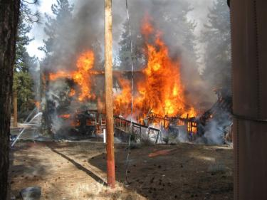 View of the fully-involved structure fire at Camp Lakota in Cuddy Valley. [Eubank Photo]