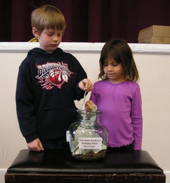Matthew Sarmiento and Alexandra Saenz, first graders at Gorman School, raise money for Haiti