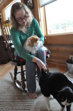 Alisa McDonald packed her bags and said goodbye to family cats Miles and Felix as she left for the Peace Corps.