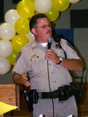 In sad news today, March 27, 2010, California Highway Patrol Officer Mark Ehly's family announced that he died at about 10:50 a.m. after a second massive stroke. This is a photo of Ehly from a happier time, talking with Frazier Mountain High School students about Casey's Pledge and the effort to stop drunk driving in California.[Sara Woerter Photo]