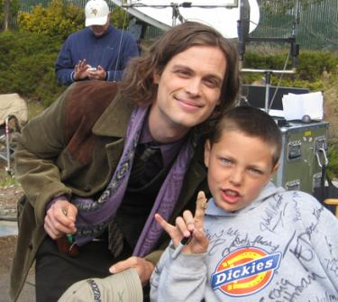 Actor Matthew Gubler added little cartoons to his autographs. Here he is, mid-drawing, with Drew Ludwig.
