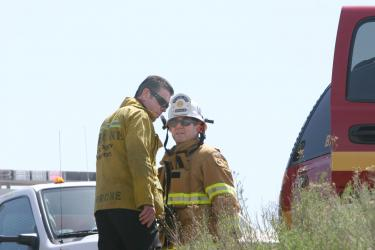 Kern County Fire Department Battalion Chief Kirk Kushen (right) confers with an unidentified firefighter from Los Angeles County. [Photo by Gary Meyer of The Mountain Enterprise]
