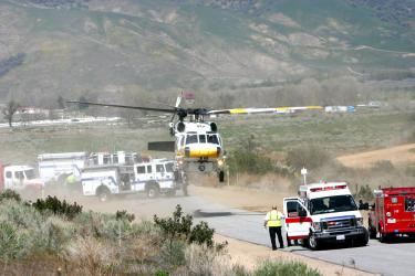 Los Angeles County Fire Department's Helicopter 15 lifts off with one of the injured onboard. [Photo by Gary Meyer of The Mountain Enterprise]