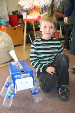 Matthew Lowe with the dog he made out of clean trash for an Earth Day recycling assignment in Mrs. Penner's kindergarten class at Frazier Park School.