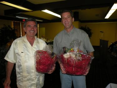 Outgoing board members (l-r) Lee Benavidez and John Dilibert who received a gift basket from the association to show appreciation for their volunteer service. Both outgoing directors had been caught up in a swirl of discord during the past year revolving around allegations of retaliation against the PMCPOA patrol.