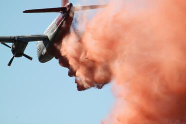 Tankers working with helicopters to lay fire retardant helped keep both fires in control. [CHP Sgt. Darrell Brooks photo