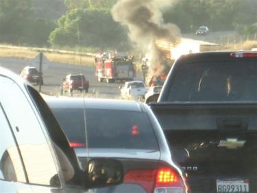As traffic was allowed to move slowly forward in the inner lanes, he caught this sigt of the blaze, along with Los Angeles County firefighters responding.